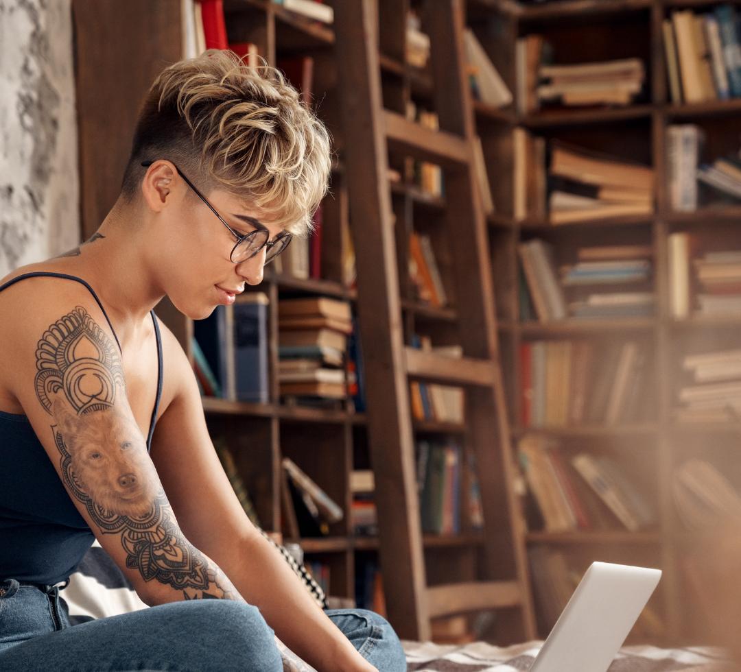 tattooed woman on laptop
